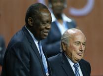 Issa Hayatou (L), Senior Vice President of the FIFA stands with FIFA President Sepp Blatter after he was re-elected at the 65th FIFA Congress in Zurich, Switzerland, May 29, 2015.     REUTERS/Arnd Wiegmann