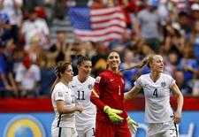 Jun 16, 2015; Vancouver, British Columbia, CAN; United States goalkeeper Hope Solo (1) and defender Becky Sauerbrunn (4) and defender Meghan Klingenberg (22) and defender Ali Krieger (11) celebrate their win over Nigeria in a Group D soccer match in the 2015 FIFA women's World Cup at BC Place Stadium. Michael Chow-USA TODAY Sports