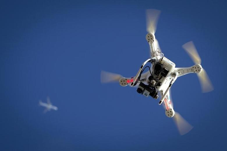 An airplane flies over a drone  in the Brooklyn borough of New York January 1, 2015.   REUTERS/Carlo Allegri