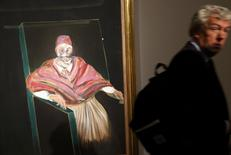 "A visitor passes by ""Study for a Pope I"" by Francis Bacon at Sotheby's in London, Britain June 19, 2015. The painting is estimated to earn US $36.5-51.1M (25-35M GB pounds) when it goes on auction July 1 in London. REUTERS/Suzanne Plunkett"