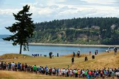 The group of Jordan Spieth , Jason Day and Justin Rose on the 3rd green in the first round of the 2015 U.S. Open golf tournament at Chambers Bay.   Mandatory Credit: John David Mercer-USA TODAY Sports