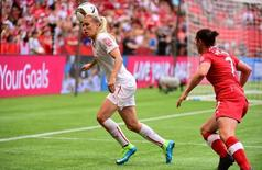 Jun 21, 2015; Vancouver, British Columbia, CAN; Switzerland forward Lara Dickenmann (11) heads the ball as Canada defender Rhian Wilkinson (7) defends at right in the first half of a game in the round of sixteen in the FIFA 2015 women's World Cup soccer tournament at BC Place Stadium. Mandatory Credit: Anne-Marie Sorvin-USA TODAY Sports