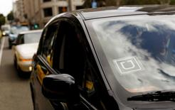 The Uber logo is seen on a vehicle near Union Square in San Francisco, California in this May 7, 2015 file photo.   REUTERS/Robert Galbraith