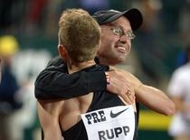 May 30, 2014; Eugene, OR, USA; Galen Rupp (USA) embraces coach Alberto Salazar after winning the 10,000m in an American record 26:44.39 in the 40th Prefontaine Classic at Hayward Field. Kirby Lee-USA TODAY Sports