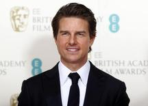 Actor Tom Cruise poses at the British Academy of Film and Arts (BAFTA) awards ceremony at the Royal Opera House in London February 8, 2015. REUTERS/Suzanne Plunkett