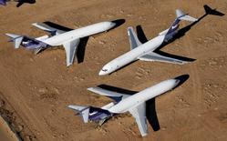 Old airplanes, including Boeing 747-400s, are stored in the desert in Victorville, California March 13, 2015.  REUTERS/Lucy Nicholson
