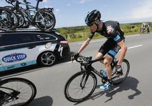 Christopher Froome of Britain cycles among the pack after crashing during the 163.5 km fourth stage of the Tour de France cycling race from Le Touquet-Paris-Plage to Lille July 8, 2014.                  REUTERS/Jean-Paul Pelissier