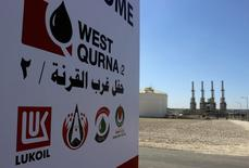 The company logo of Lukoil is seen in West Qurna oilfield in Iraq's southern province of Basra, March 29, 2014. Production from Iraq's giant West Qurna-2 oilfield will lift national output to 4 million barrels per day (bpd) by the end of the year, oil minister Abdul Kareem Luaibi said on Saturday. Russia's Lukoil began commercial production from the field on Saturday with initial output of 120,000 bpd, which is expected to rise to 400,000 bpd by the end of the year, and eventually reach 1.2 million. REUTERS/Essam Al-Sudani (IRAQ - Tags: BUSINESS LOGO POLITICS ENERGY)