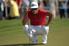 Rafa Cabrera-Bello of Spain lines up his putts on the fifth green during the final round of the DP World Tour Championship in Dubai November 23, 2014. REUTERS/Nikhil Monteiro