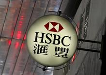 A logo of HSBC is displayed outside a branch at the financial Central district in Hong Kong, China June 2, 2015.  REUTERS/Bobby Yip