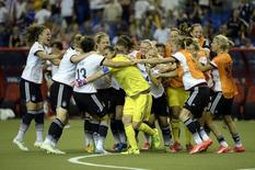Jun 26, 2015; Montreal, Quebec, CAN; Germany goalkeeper Nadine Angerer (1) celebrates with teammates after making a save on the final penalty kick to defeat France during in penalty kicks during the quarterfinals of the FIFA 2015 Women's World Cup at Olympic Stadium. Mandatory Credit: Eric Bolte-USA TODAY Sports