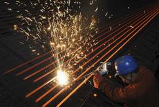 An employee works at a steel factory in Dalian, Liaoning province, in this January 19, 2009 file photo.  REUTERS/China Daily/Files