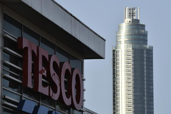 Signage is seen at a Tesco supermarket in central London, December 9, 2014. EUTERS/Toby Melville