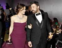 Jennifer Garner and Ben Affleck leave the Governors Ball following the 85th Academy Awards in Hollywood, California in a February 24, 2013 file photo. REUTERS/ Lucas Jackson/files