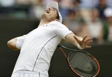 Andy Murray of Britain serves during his match against Robin Haase of the Netherlands at the Wimbledon Tennis Championships in London, July 2, 2015.          REUTERS/Henry Browne