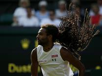Dustin Brown of Germany serves during his match against Rafael Nadal of Spain at the Wimbledon Tennis Championships in London, July 2, 2015.  REUTERS/Stefan Wermuth