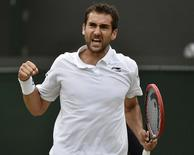 Marin Cilic of Croatia reacts during his match against John Isner of the U.S.A. at the Wimbledon Tennis Championships in London, July 3, 2015.   REUTERS/Toby Melville