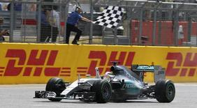 Formula One - F1 - British Grand Prix 2015 - Silverstone, England - 5/7/15 Mercedes' Lewis Hamilton celebrates as he crosses the finish line to win the race Reuters / Andrew Yates