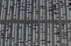 An aerial picture shows new Chevrolet cars at a General Motors' parking lot in Shenyang, Liaoning province, China, June 28, 2015. REUTERS/Stringer