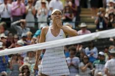 Maria Sharapova of Russia celebrates after winning her match against Zarina Diyas of Kazakhstan at the Wimbledon Tennis Championships in London, July 6, 2015.                   REUTERS/Suzanne Plunkett