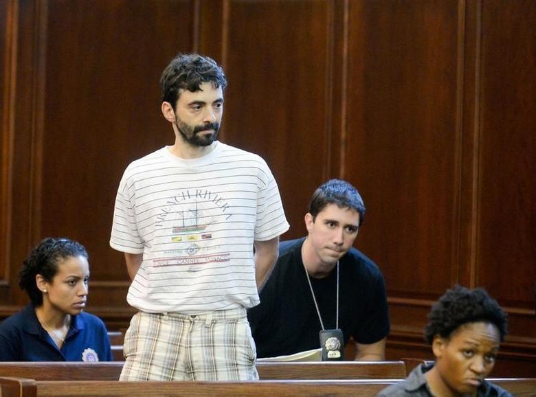 Former Goldman Sachs computer programmer Sergey Aleynikov (2nd L) waits to appear in Manhattan Criminal Court at New York, August 9, 2012. REUTERS/Steven Hirsch/Pool
