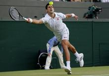 Novak Djokovic of Serbia hits a shot during his match against Kevin Anderson of South Africa at the Wimbledon Tennis Championships in London, July 6, 2015.                   REUTERS/Suzanne Plunkett