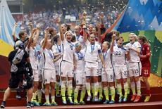 Jul 5, 2015; Vancouver, British Columbia, CAN; The United States celebrate after defeating Japan in the final of the FIFA 2015 Women's World Cup at BC Place Stadium. United States won 5-2. Mandatory Credit: Michael Chow-USA TODAY Sports