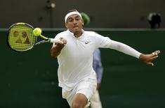 Nick Kyrgios of Australia hits a shot during his match against Richard Gasquet of France at the Wimbledon Tennis Championships in London, July 6, 2015.                REUTERS/Henry Browne