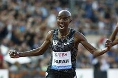 Mo Farah of Britain finishes the 5000 metres men event at the IAAF Diamond League Athletissima athletics meeting at the Pontaise Stadium in Lausanne, Switzerland, July 9, 2015.      REUTERS/Pierre Albouy