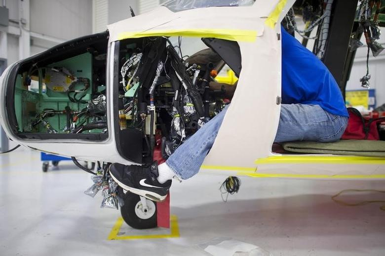An aircraft technician assembles an S-76D helicopter at Sikorsky Global Helicopters in Coatesville, Pennsylvania October 16, 2014.  REUTERS/Mark Makela