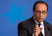 French President Francois Hollande speaks during a news conference following a euro zone leaders summit in Brussels, Belgium, July 7, 2015. Greece faces a last chance to stay in the euro zone on Tuesday when Prime Minister Alexis Tsipras puts proposals to an emergency euro zone summit after Greek voters resoundingly rejected the austerity terms of a defunct bailout.   REUTERS/Philippe Wojazer      TPX IMAGES OF THE DAY