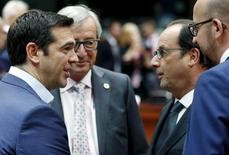 (L-R) Greece's Prime Minister Alexis Tsipras, European Commission President Jean-Claude Juncker, France's President Francois Hollande and Belgium's Prime Minister Charles Michel attend an euro zone leaders summit in Brussels, Belgium, July 12, 2015.  REUTERS/Francois Lenoir