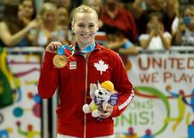 Jul 13, 2015; Toronto, Ontario, CAN; Ellie Black of Canada celebrates on the podium after winning the women's gymnastics all around final during the 2015 Pan Am Games at Toronto Coliseum. Mandatory Credit: Geoff Burke-USA TODAY Sports