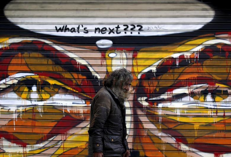 A man walks by a mural in Athens, Greece July 14, 2015, REUTERS/Yannis Behrakis
