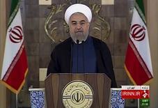 El presidente iraní, Hassan Rouhani, dando un discurso, en una imagen congelada tomada de una transmisión por video de IRINN, 14 de julio de 2015. El presidente iraní, Hassan Rouhani, dijo el martes que el  acuerdo nuclear con grandes potencias abrirá un nuevo capítulo de cooperación con el mundo exterior después de años de sanciones, y estimó que este resultado favorable para todas las partes terminará gradualmente con la desconfianza mutua. REUTERS/IRINN via Reuters TV         Imagen para uso no comercial, ni ventas, ni archivos. Solo para uso editorial. No para su venta en mercadeo o campañas publicitarias. Esta imagen fue entregada por un tercero y es distribuida, exactamente como fue recibida por Reuters, como un servicio para clientes.