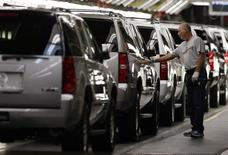 A General Motors employee inspects a SUV on the assembly line at the GM assembly plant in Arlington, Texas in this November 18, 2008 file photo. REUTERS/Jessica Rinaldi/Files