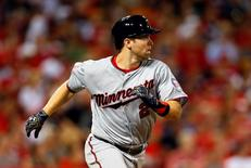 American League second baseman Brian Dozier (2) of the Minnesota Twins runs the bases after hitting a solo home run against the National League during the eighth inning of the 2015 MLB All Star Game at Great American Ball Park. Rick Osentoski-USA TODAY Sports