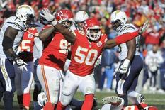 Dec 28, 2014; Kansas City, MO, USA; Kansas City Chiefs outside linebacker Justin Houston (50) celebrates after a sack against the San Diego Chargers in the first half at Arrowhead Stadium. Mandatory Credit: John Rieger-USA TODAY Sports