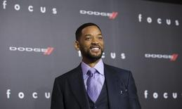 "Cast member Will Smith poses at the premiere of ""Focus"" at the TCL Chinese theatre in Hollywood, California February 24, 2015.  REUTERS/Mario Anzuoni"