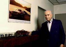 File photo from 1995 showing Argentina's five-time Formula One world champion Juan Manuel Fangio, next to a model of one of the cars that he drove during his long Formula One career.  REUTERS/FILE