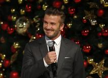 David Beckham speaks before launching Christmas lights at the Marina Bay Sands shopping mall in Singapore November 15, 2014. REUTERS/Edgar Su