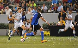 Los Angeles Galaxy midfielder Steven Gerrard (8) moves the ball against San Jose Earthquakes midfielder Sanna Nyassi (17) and defender Victor Bernardez (5) during the first half at StubHub Center.  Gary A. Vasquez-USA TODAY Sports