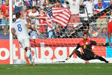 United States forward Clint Dempsey (8) scores on Cuba goalkeeper Disovelis Guerra (21) on a penalty kick during the second half of the CONCACAF Gold Cup quarterfinal match at M&T Bank Stadium. United States defeated Cuba 6-0. Mandatory Credit: Tommy Gilligan-USA TODAY Sports