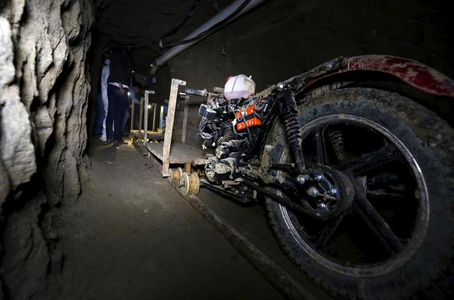 A motorcycle modified to run on rails is seen inside a tunnel connected to the Altiplano Federal Penitentiary and used by drug lord Joaquin 'El Chapo' Guzman to escape, in Almoloya de Juarez, on the outskirts of Mexico City, July 15, 2015. REUTERS/Edgard Garrido