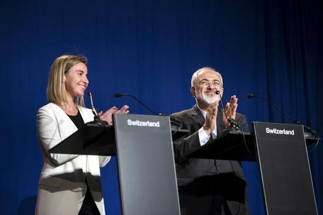 European Union High Representative for Foreign Affairs and Security Policy Federica Mogherini (L) and Iranian Foreign Minister Javad Zarifat clap after making statements following nuclear talks at the Swiss Federal Institute of Technology in Lausanne (Ecole Polytechnique Federale De Lausanne) April 2, 2015. REUTERS/Brendan Smialowski/Pool