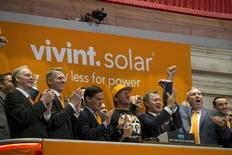 Vivint Solar CEO Greg Butterfield (3rd R)   ring the opening bell at the New York Stock Exchange  October 1, 2014.  REUTERS/Brendan McDermid