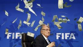 REFILE - QUALITY REPEAT British comedian known as Lee Nelson (unseen) throws banknotes at FIFA President Sepp Blatter as he arrives for a news conference after the Extraordinary FIFA Executive Committee Meeting at the FIFA headquarters in Zurich, Switzerland July 20, 2015. REUTERS/Arnd Wiegmann