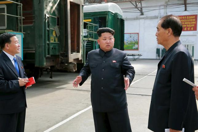 North Korean leader Kim Jong Un provides field guidance to the Kim Jong Thae Electric Locomotive Complex in this undated photo released by North Korea's Korean Central News Agency (KCNA) in Pyongyang on July 20, 2015. REUTERS/KCNA