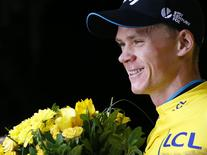 Team Sky rider Chris Froome of Britain wears the race leader's yellow jersey on the podium after the 161-km (100 miles) 17th stage of the 102nd Tour de France cycling race from Digne-les-Bains to Pra Loup in the French Alps mountains, France, July 22, 2015. REUTERS/Stefano Rellandini