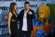 "Actor Adam Sandler and his wife Jackie attend the premiere of the movie ""Pixels"" in New York July 18, 2015. REUTERS/Eduardo Munoz"